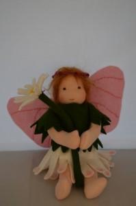 flower fairy sitting
