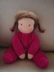 knuffelpopje roze zittend