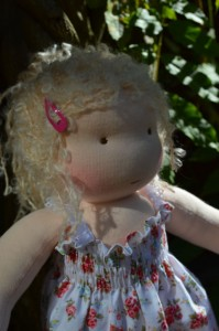 Waldorf doll in garden
